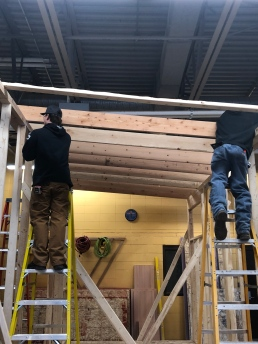 Students putting up Rafters