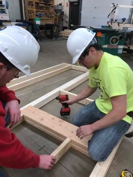 Students Framing the Walls and Window Header